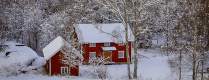 Old farm houses in a winter landscape. Old red farm houses surrounded by snowy winter landscape, down in a valley shot Stock Images