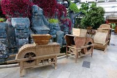 Old farm implements. The old farm implements are placed in modern garden Royalty Free Stock Images