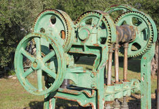 Old farm machinery. Used for pressing grapes in the manufacture of wine stock images