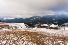 Old farm in the mountains at winter Stock Image