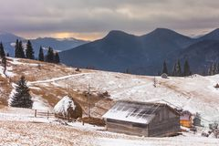 Old farm in the mountains at winter.  Stock Photos