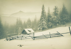 Old farm in the mountains at winter Stock Photography