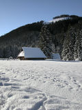 Old farm in the mountains at winter. Zakopane, Poland Royalty Free Stock Images