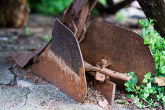 Old farm plow in the garden stock images