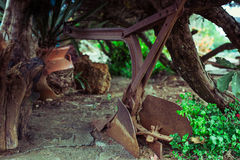 Old farm plow in the garden stock photo