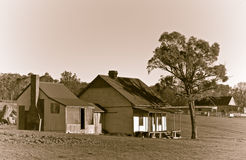 Old farm ranch in sepia. An old house of a cattle station or ranch in the middle of the field in sepia Royalty Free Stock Images