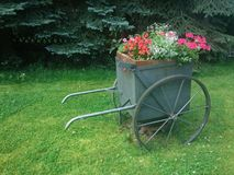 Old farm retro flower wagon Royalty Free Stock Photography