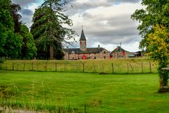 An old farm in Scotland looks like a church, red shutters stand out stock photos