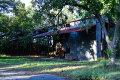 Old Farm Shed. Left behind to rust on an old farm in Rembert, SC.  Rusty Metal Building in the country Royalty Free Stock Photos