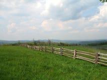 Old Farm Stead. A primitive fence stretches across farmland  in Blue Ridge National Park Royalty Free Stock Photos