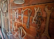 Old farm tools hung on a wall stock photos