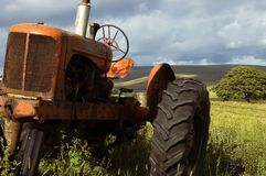 Old farm tractor. In rural area Stock Photo