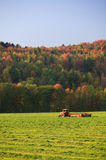 Old farm tractor in a field. Old farm tractor in a mowed field in Stowe Vermont, USA Royalty Free Stock Photos