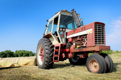Old Farm Tractor. An old tractor in a freshly mowed field stock photography