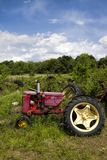 Old Junkyard Farm Tractor Body Parts. This is a old farm tractor graveyard with every kind of  junked parts Royalty Free Stock Image