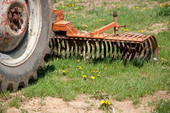 Old farm tractor plow Stock Image