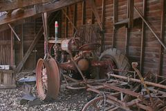 Old Farm Tractor. Sitting in what used to be a barn Royalty Free Stock Images
