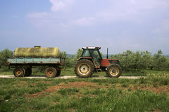 Old farm tractor with van Royalty Free Stock Photos