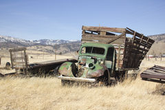 Old farm truck in a field of junk Stock Images