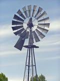 Old Farm Windmill. Against blue Colorado sky Stock Photo