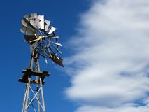 Old Farm Windmill. Against Blue Sky with Clouds Stock Photography