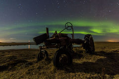 Old Farmall & Northern Lights Royalty Free Stock Photo