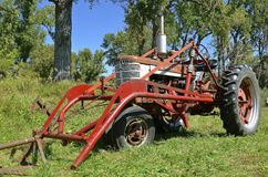 Old Farmall tractor with a front end loader Stock Images