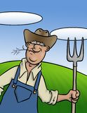 Old Farmer. An old farmer with his trusty pitch fork Stock Image