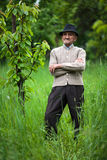 Old farmer in his orchard Stock Images