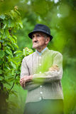 Old farmer in his orchard Stock Photo