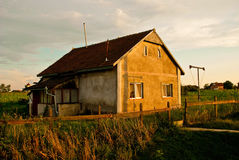Old farmer house at sunset romania Stock Images