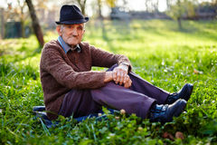 Old farmer resting Stock Photo