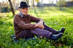 Old farmer resting Stock Photo