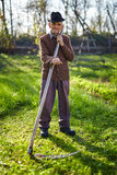 Old farmer with scythe Royalty Free Stock Photography