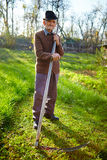 Old farmer with scythe Royalty Free Stock Photo