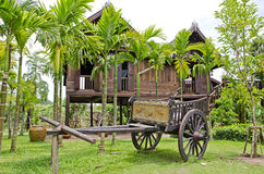 Old farmer wooden cart and Thai house style. Stock Photo