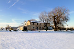 Old farmhouse. An old abandoned farmhouse in the middle of a country field just after a snowfall Royalty Free Stock Photography
