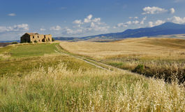 Old farmhouse. Typical tuscan landscape with an old ruin of a farmhouse Stock Photography