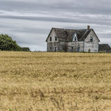 Old Farmhouse. Old abandoned farmhouse collapsing into the earth Stock Photos