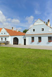 Old farmhouse with blue plaster. Rural decorated houses in Zabori, Czech Republic. UNESCO World Heritage Site in South Bohemia Royalty Free Stock Photography