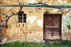 Old farmhouse facade. With Wood door and window stock photo