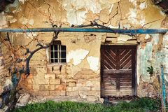Old farmhouse facade. With Wood door and window royalty free stock photos