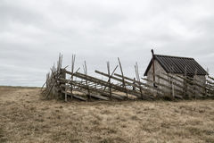 Old farmhouse in the field royalty free stock image