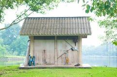 Old farmhouse in garden Stock Image