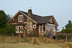 Old Farmhouse with Hay Field Royalty Free Stock Image