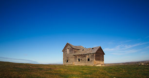 Old farmhouse on hill, panorama Stock Images