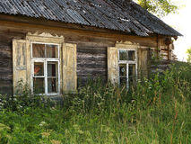 Old farmhouse i summer day Royalty Free Stock Images