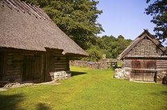 Old farmhouse and little barn. Traditional thatched roof farmhouse located in Estonia, National Open Air Museum stock photo