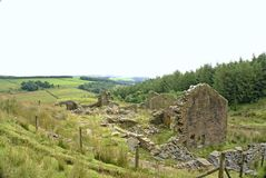Old farmhouse ruin. Looking past an old farm ruin down the Rossendale valley across fields and meadows Stock Photography