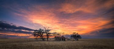 Old Farmhouse at Sunset on the Plains